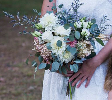 Traditional wedding bouquets with a twist: lush, natural creams and gorgeous foliage