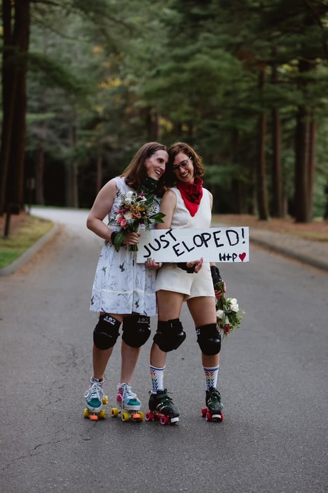 """women in roller derby gear with a """"just eloped"""" sign"""