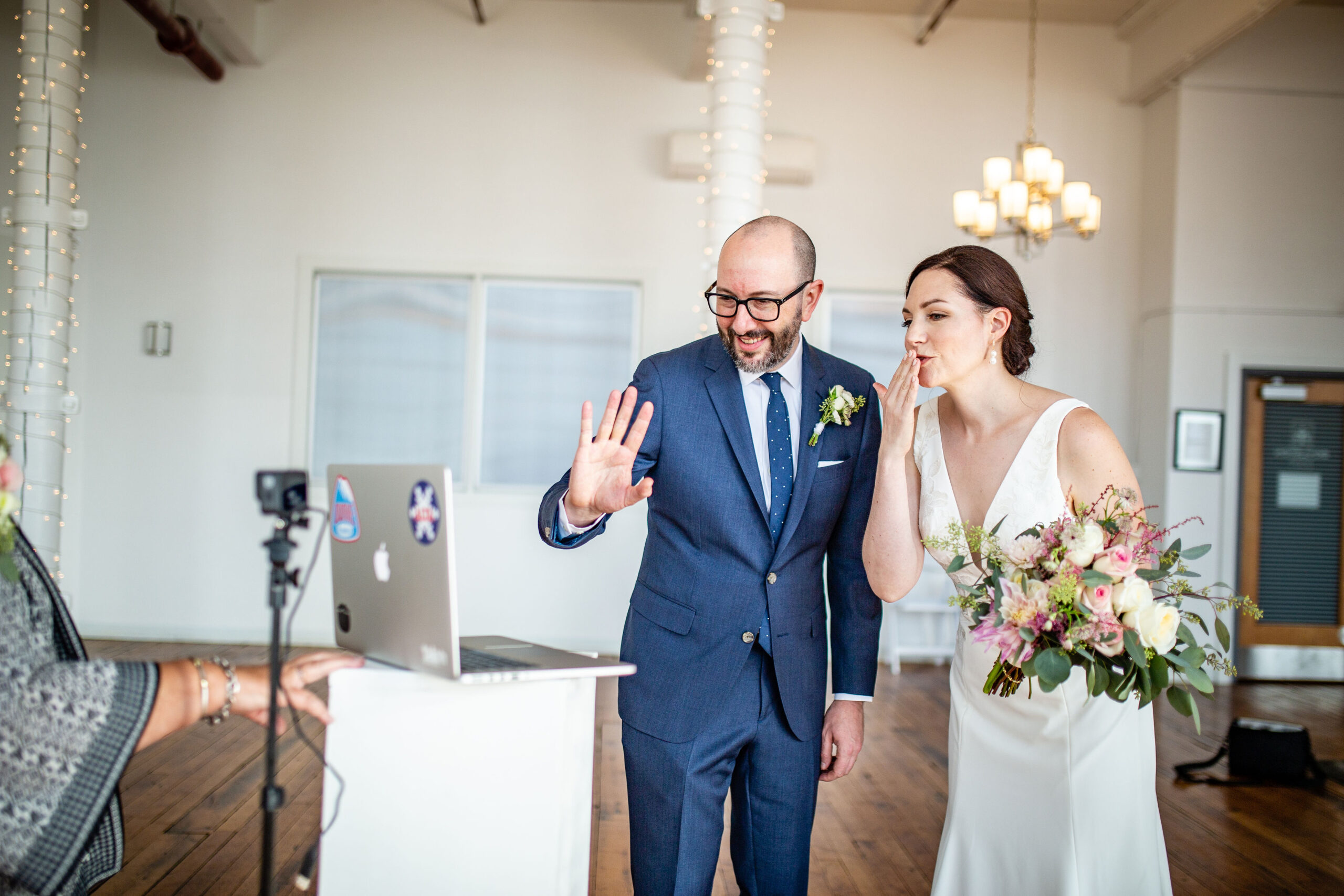 wedding couple looking at computer screen